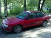 Продам Ниссан примеру красный седан 1993г